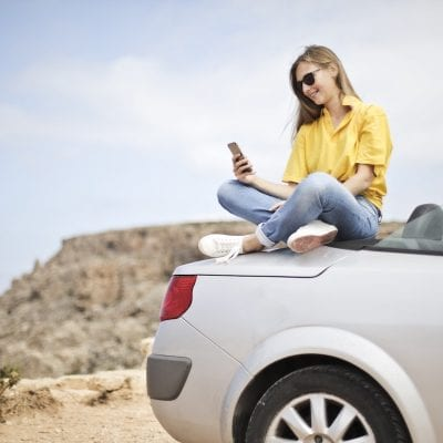 Car Insurance - Girl Sitting On Car