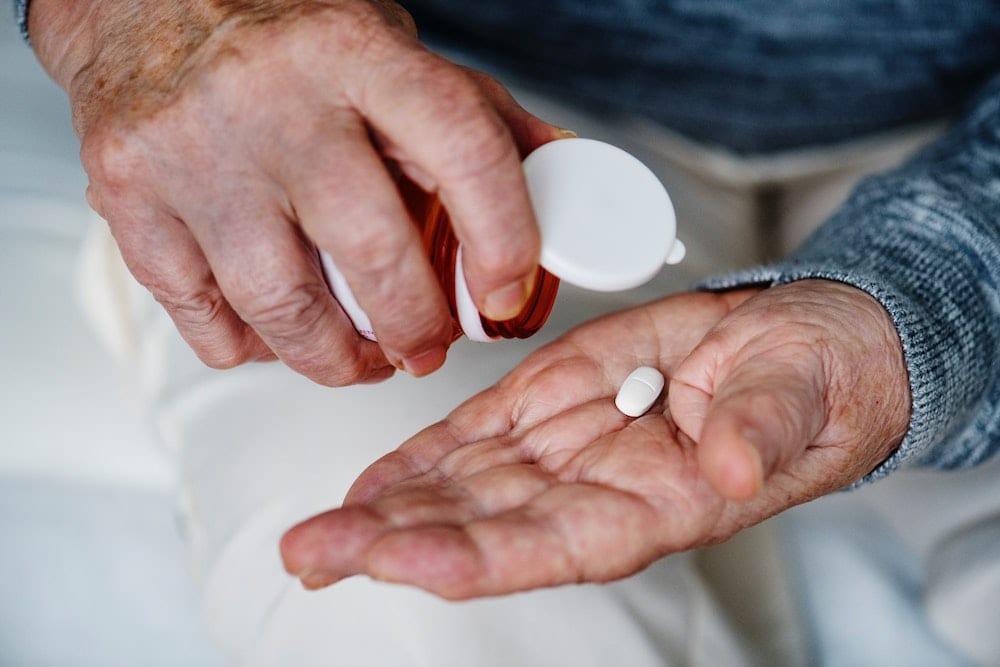 Elderly Patient Taking Medication