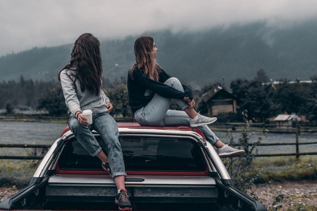 Teen Drivers Sitting on Car